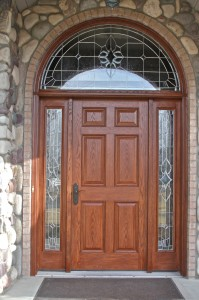 Delightful Entry Door With Side Panes And Large Arched Transent Window Above