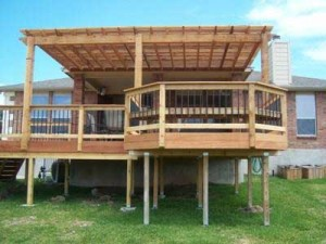 back deck with pergola and hexagon seating area