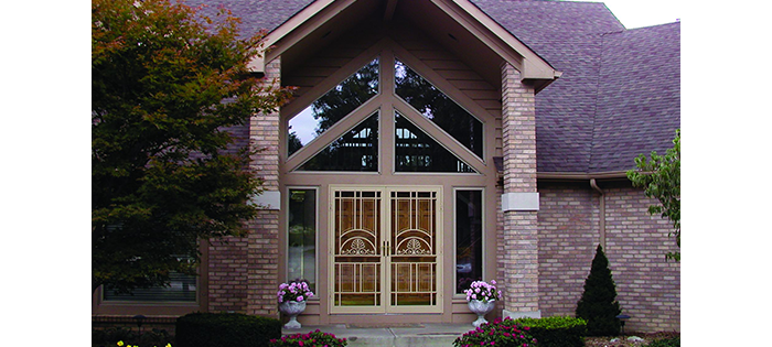 mission style arts and crafts style front entry door with geometric windows above double wood door